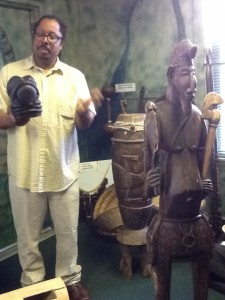 Dr. Aden discusses the lives of Africans using scultpures in the museum.