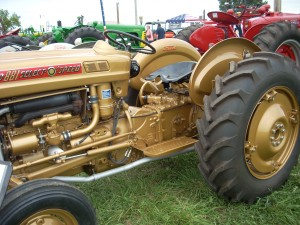 Gold 1959 Demonstrator Ford 881 tractor on display at Greensburg Power of the Past.
