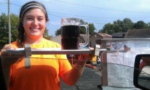 A car hop at B-K Drive-In in Huntington serves your order at your vehicle with a smile.