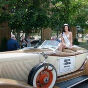 silver car with beauty queen
