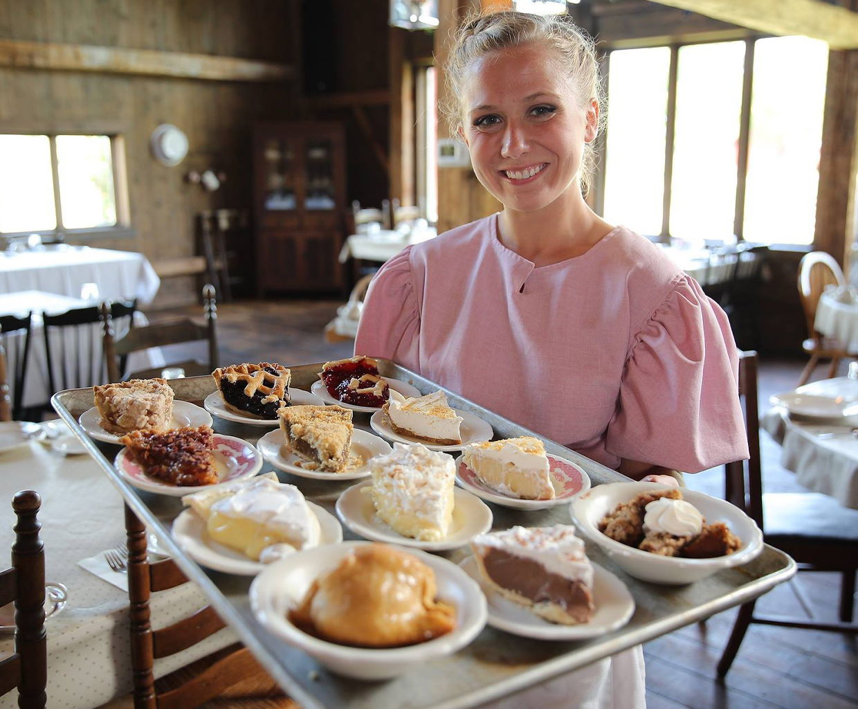 Waitress holding a try of pies at Amish Acres Restaurant Barn in Nappanee